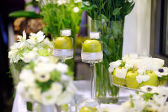 Beautiful bouquet of green apples and a candles Stock Photo