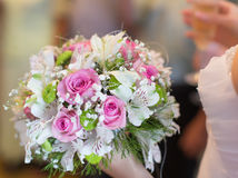Beautiful bouquet in hand of bride Royalty Free Stock Photography