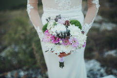 Beautiful bouquet in hands of the bride Royalty Free Stock Photography