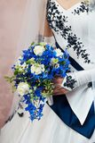 Beautiful bouquet in her hand the bride Royalty Free Stock Images