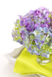 Beautiful bouquet of hydrangeas with glass vase Stock Photos