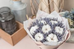 Beautiful bouquet lavender and cotton, on table . dried flowers white and lilac color.  royalty free stock photo