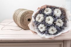 Beautiful bouquet lavender and cotton, on table . dried flowers white and lilac color.  royalty free stock image