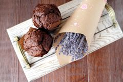 Beautiful bouquet of lavender and muffins for Breakfast Royalty Free Stock Photos