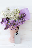 Beautiful bouquet of  lilac with  empty message card Stock Photos