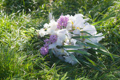 Beautiful bouquet of lilacs and irises Royalty Free Stock Photos