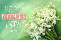 Beautiful bouquet of lilies of the valley. Mother`s day greeting concept.  royalty free stock images