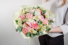 Beautiful bouquet made of different flowers with in woman hand . colorful color mix flower Royalty Free Stock Photos
