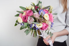 Beautiful bouquet made of different flowers with in woman hand . colorful color mix flower Stock Images
