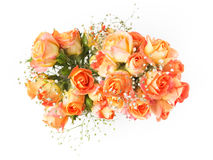 Beautiful bouquet of orange roses on white background. Top view. Royalty Free Stock Photos