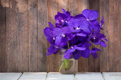 Beautiful bouquet of orchids flower on a wooden background Royalty Free Stock Photos
