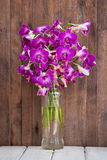 Beautiful bouquet orchids flower on wooden table Stock Photography