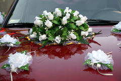 Beautiful bouquet of ornamental flowers on the hood of the car Royalty Free Stock Photos