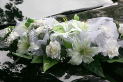Beautiful bouquet of ornamental flowers on the hood of the car Stock Photography
