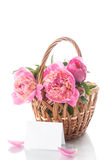 Beautiful bouquet of peonies in a basket Stock Photography