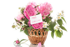 Beautiful bouquet of peonies and jasmine in a basket Royalty Free Stock Photos