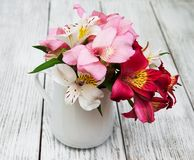 Beautiful bouquet of pink alstroemeria. In the vase Stock Photo