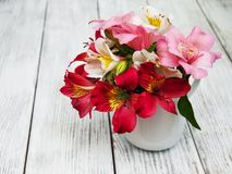 Beautiful bouquet of pink alstroemeria. In the vase Stock Photos