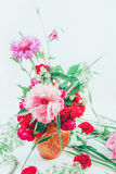 Beautiful bouquet of pink flowers peons, cornflowers and red roses tinted photo. Floral design. beautiful bouquet of pink flowers peons, cornflowers and red Stock Images