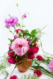 A beautiful bouquet of pink peonies, cornflowers and red roses. Floral design. A beautiful bouquet of pink peonies, cornflowers and red roses royalty free stock images