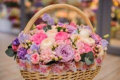 Beautiful bouquet of pink , purple flowers in basket. Beautiful bouquet of bright different pink , purple flowers in basket stock images