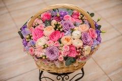 Beautiful bouquet of pink , purple flowers in basket. Beautiful bouquet of bright different pink , purple flowers in basket stock photos