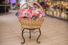 Beautiful bouquet of pink , purple flowers in basket Royalty Free Stock Photos