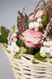 Beautiful bouquet of pink roses in basket Royalty Free Stock Images