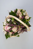 Beautiful bouquet of pink roses in basket Royalty Free Stock Photos