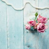 Beautiful bouquet of pink roses on a blue wooden background.  Stock Photo