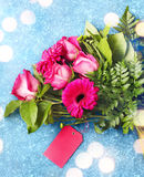 Beautiful bouquet of pink roses and gerberas with paper tags Royalty Free Stock Photos