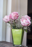 Beautiful bouquet of pink  roses -in green vase Stock Photo