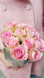 Beautiful bouquet of pink roses in woman`s hands royalty free stock photo