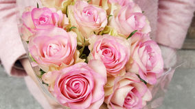 Beautiful bouquet of pink roses in woman`s hands stock image