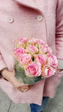 Beautiful bouquet of pink roses in woman`s hands stock photography