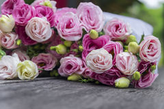Beautiful bouquet of pink roses on wooden background Royalty Free Stock Images