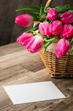 Beautiful bouquet of pink tulips and congratulations on the tabl stock photography