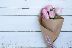 Beautiful bouquet of pink tulips in paper Stock Photos