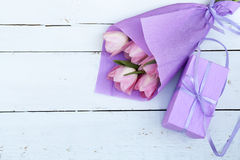 Beautiful bouquet of pink tulips in violet paper and gift Stock Images