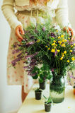 Beautiful bouquet of purple and yellow wildflowers in the room light on a white table. Royalty Free Stock Image