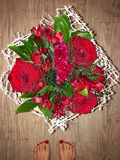 Beautiful bouquet with red roses in a white wrapper. View royalty free stock image