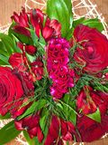 Beautiful bouquet with red roses in a white wrapper. View stock photography