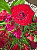 Beautiful bouquet with red roses in a white wrapper. View stock photo