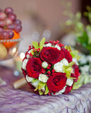 Beautiful bouquet of rose flowers on table. Wedding bouquet of red roses. Elegant wedding bouquet on table at restaurant. Beautiful bouquet of rose flowers, on Royalty Free Stock Images
