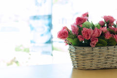 Beautiful bouquet rose pink flower artificial in basket Stock Images