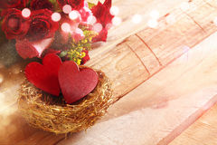 Beautiful bouquet of roses and couple of red hearts Royalty Free Stock Photography