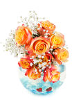 Beautiful bouquet of roses in a glass round vase Stock Photo