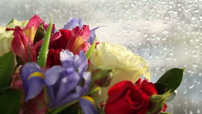 Beautiful bouquet roses, iris and alstroemeria quickly rotating. stock video footage