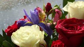 Beautiful bouquet roses, iris and alstroemeria rotates. stock footage