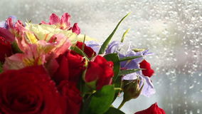 Beautiful bouquet roses, iris and alstroemeria rotates. stock video footage